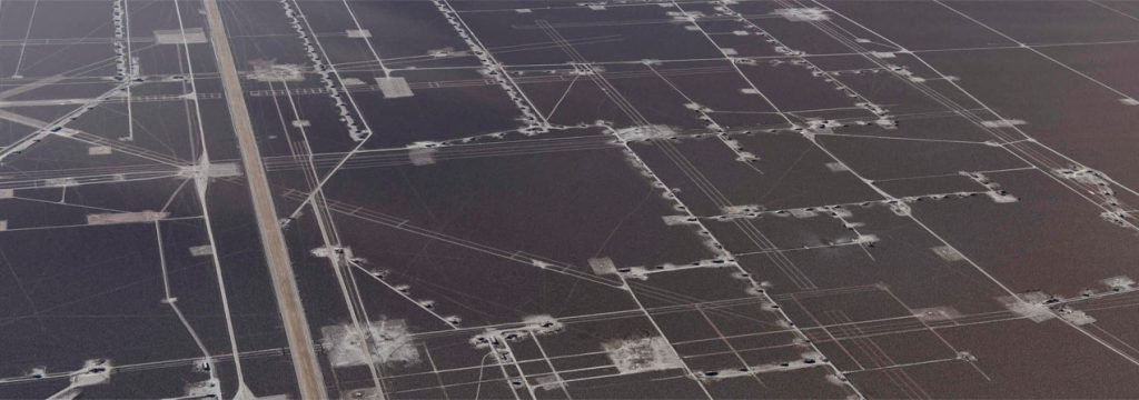 fotografía aérea que muestra el uso que hacemos del suelo, haciendo alusion a las huellas de carbono que vamos dejando